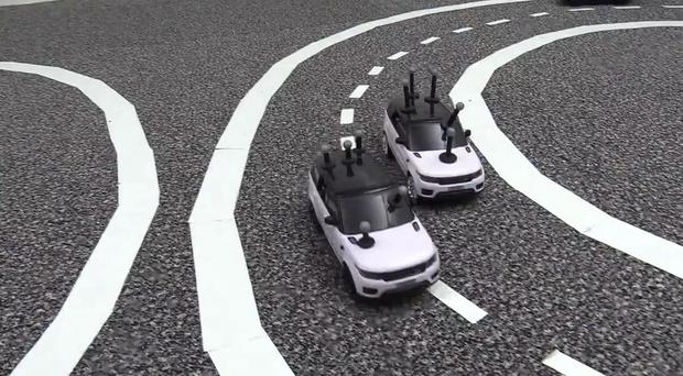 The mini robotic cars were put to the test on a track (Cambridge University/PA