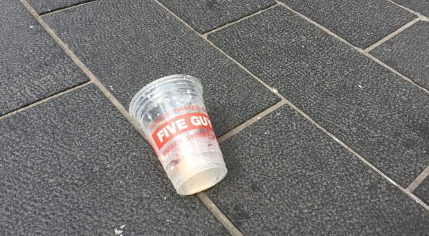 The empty milkshake cup from Five Guys which is believed to have been emptied on Nigel Farage in Newcastle city centre during a Brexit Party walkabout (Tom Wilkinson/PA)