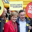 First Minister Nicola Sturgeon campaigns alongside lead SNP European election candidate Alyn Smith MEP (Jane Barlow/PA)