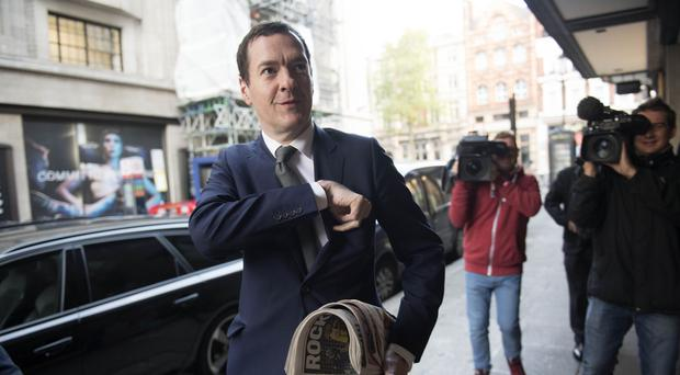 Former chancellor George Osborne is the latest in a string of party grandees to turn his back on Theresa May's Conservatives (Victoria Jones/PA)