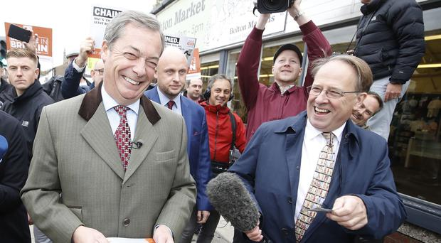 Channel 4 News journalist Michael Crick, right, with Brexit Party leader Nigel Farage (Martin Rickett/PA)