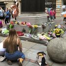 Floral tributes left in St Ann's Square in Manchester city centre to mark the second anniversary of the Manchester Arena terror attack (Kim Pilling/PA)