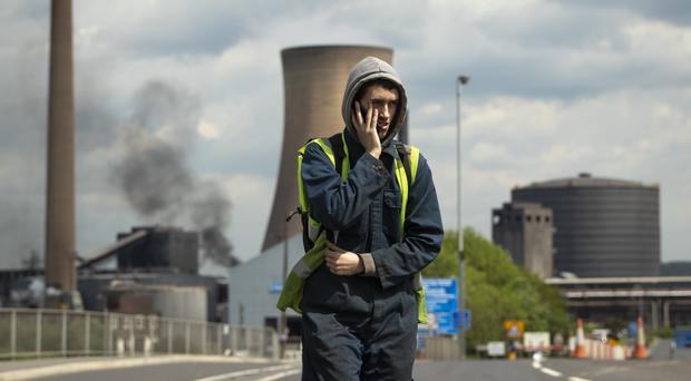 Workers leave the steelworks plant in Scunthorpe (Danny Lawson/PA)