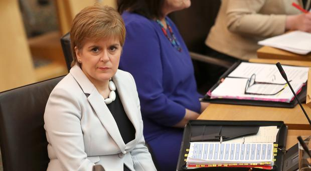 Nicola Sturgeon during First Minister's Questions at the Scottish Parliament (Jane Barlow/PA)