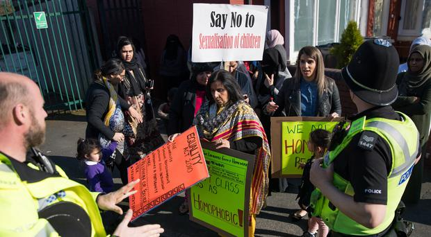 Parents, children and protesters demonstrate against lessons about gay relationships at Anderton Park Primary School in Birmingham (Aaron Chown/PA)