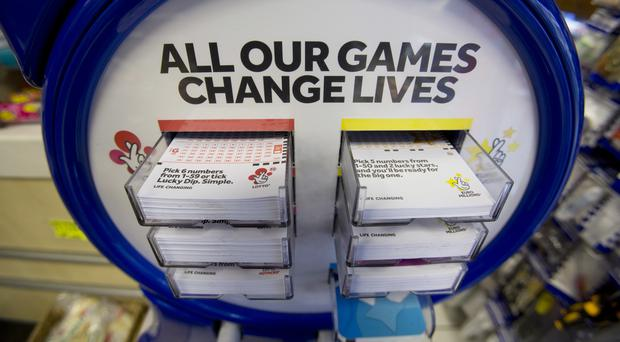 The Set For Life game pays out £10,000 per month for three decades (Yui Mok/PA)