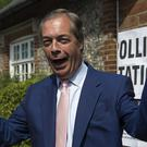 Brexit Party leader Nigel Farage arrives to cast his vote for the European Parliament elections at a polling station at the Cudham Church of England Primary School in Biggin Hill, Kent (PA)