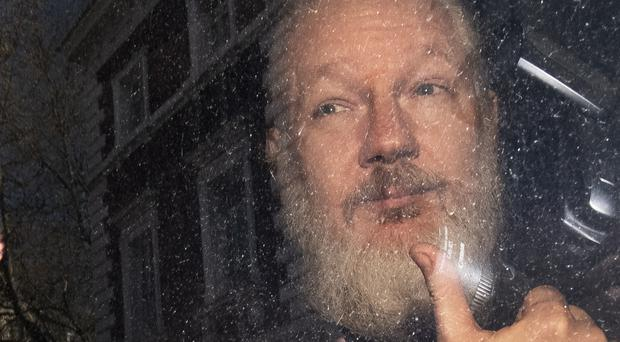 Julian Assange is currently jailed in Britain over a bail breach but US authorities are seeking his extradition (Victoria Jones/PA)