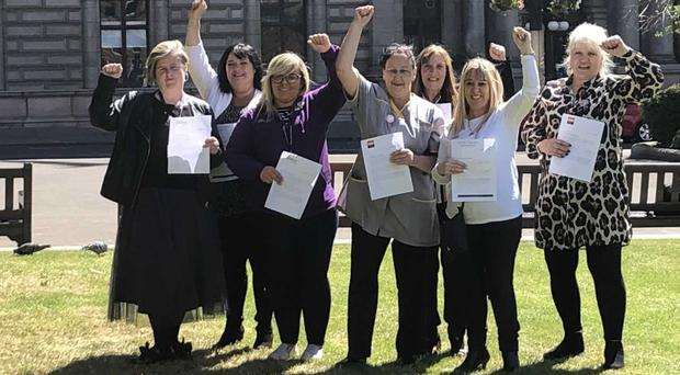 Glasgow City Council workers and union organisers celebrate being sent equal pay settlement offers (Laura Paterson/PA)
