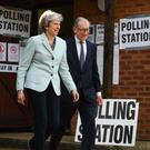 Prime Minister Theresa May and her husband, Philip, in her Maidenhead constituency (Victoria Jones/PA)