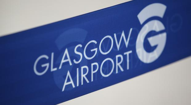 Workers at Glasgow and Aberdeen airports will go on strike at the same time (Jane Barlow/PA)