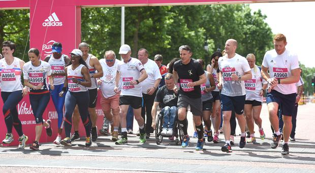 Jo Pavey, David Weir and Lord Sebastian Coe on the start line of the Olympians Mile, part of the 2017 Vitality Westminster Mile (Lauren Hurley/PA)