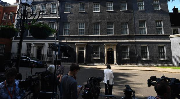 Members of the media gather outside 10 Downing Street (Victoria Jones/PA)
