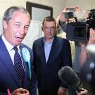 Nigel Farage speaks with the media as he arrives at the European Parliamentary elections count at the Guildhall in Southampton (Andrew Matthews/PA)