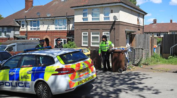 Police officers at a property on Gregg House Road in Shiregreen, Sheffield (Danny Lawson/PA)