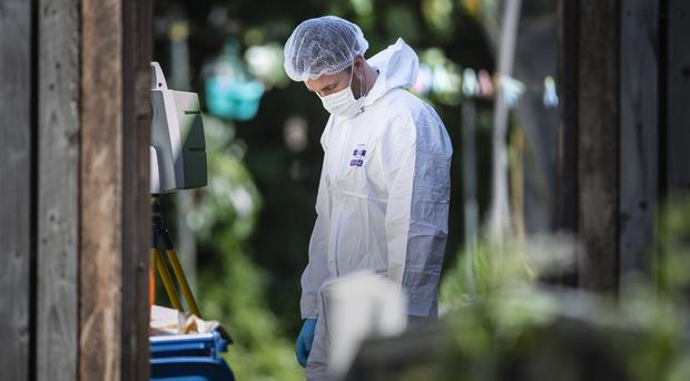 A forensic officer at a property in Shiregreen, Sheffield (Danny Lawson/PA)
