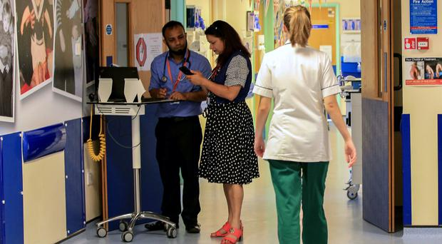 More than 23,000 patients waited longer than 12 weeks for inpatient or day case procedures, the latest NHS figures showed (Peter Byrne/PA)