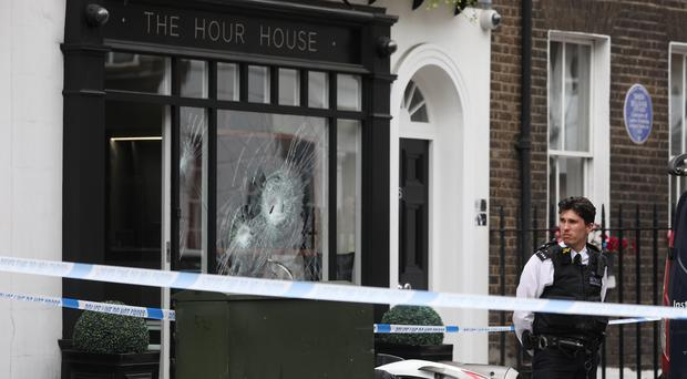Police outside The Hour House on Duke Street, Westminster (Isabel Infantes/PA)