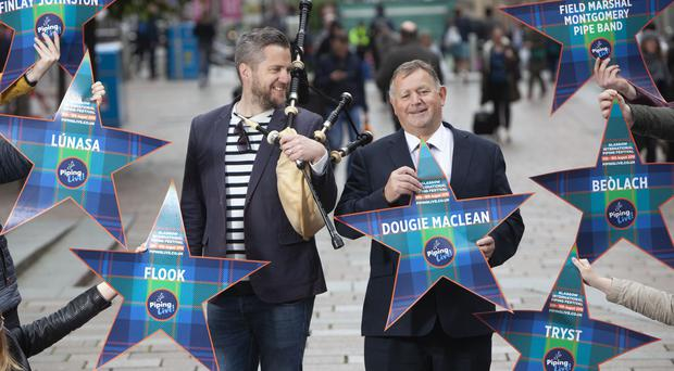 Festival director Roddy MacLeod and Finlay MacDonald in Glasgow's Buchanan Street (Chris James/PA)