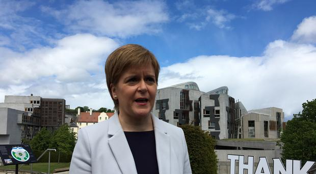 First Minister Nicola Sturgeon said she will push on with plans for IndyRef2 while the Tories and Labour are in turmoil (Tom Eden/PA)