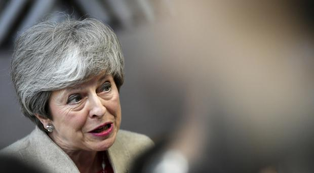 British Prime Minister Theresa May speaks with the media as she arrives for an EU summit in Brussels (AP Photo/Riccardo Pareggiani)