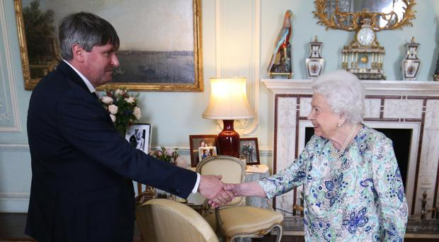 The Queen presents Simon Armitage to present with The Queen's Gold Medal for Poetry upon his appointment as Poet Laureate during an audience at Buckingham Palace, London (Jonathan Brady/PA)
