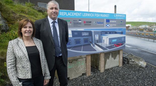 Carolyn Martin, relationship manager at Bank of Scotland, with Lerwick Port Authority chief executive Calum Grains (Citypress/PA)