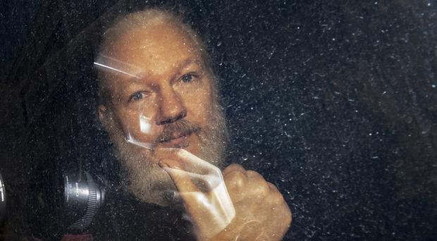 Julian Assange failed to appear in court via video-link from prison after being moved to a medical ward (Victoria Jones/PA)