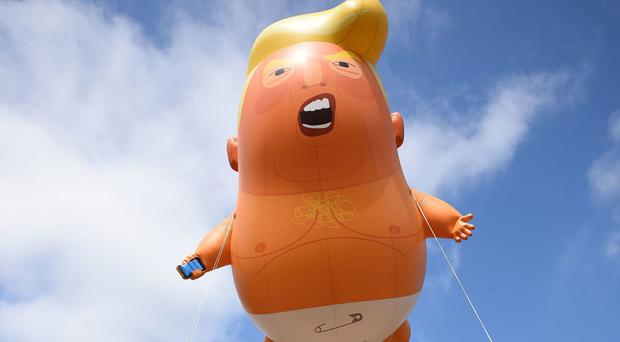 The phone-wielding, nappy-wearing inflatable Trump baby could return to London (Kirsty O'Connor/PA)