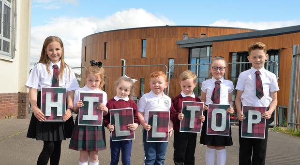 Pupils celebrate the opening of their new school (North Lanarkshire Council/PA)