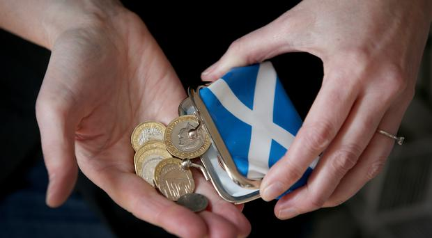 The Scottish Government could be facing a funding gap of more than £1 billion over the next three years (Jane Barlow/PA)