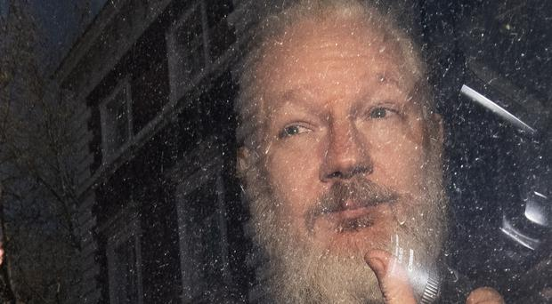 A UN official has warned Julian Assange will not get a fair trial if he is extradited to the US (Victoria Jones/PA)