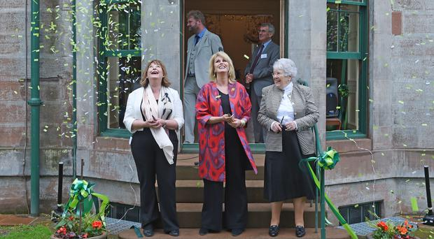 Culture Secretary Fiona Hyslop, (left) actress Joanna Lumley (centre) and Dame Barbara Kelly (right) of the PPMBT celebrate the official opening of the new visitor centre (Neil Hanna/PA)