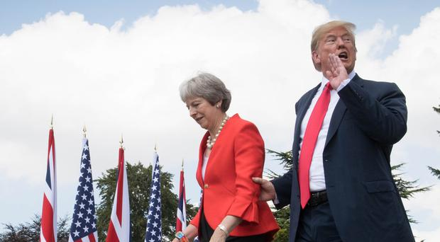 US President Donald Trump walking with Prime Minister Theresa May (Stefan Rousseau/PA)