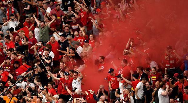 Liverpool fans celebrate Divock Origi's goal during the Champions League Final (Joe Giddens/PA)
