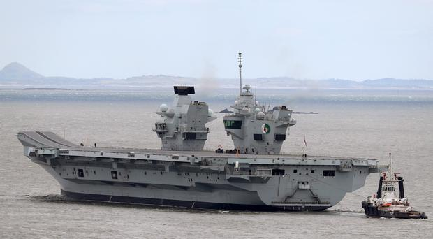 The aircraft carrier HMS Queen Elizabeth will visit the US (Andrew Milligan/PA)