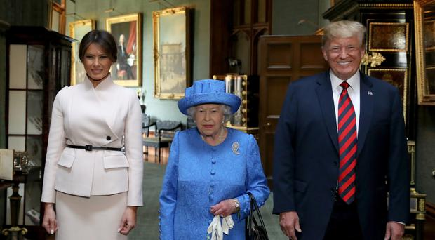 The Queen with US President Donald Trump and his wife, Melania (Steve Parsons/PA)