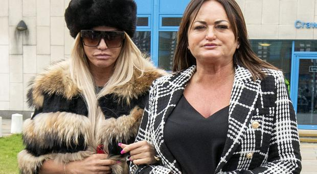 Katie Price (left) is accused of two counts of using threatening, abusive, words or behaviour to cause harassment, alarm or distress (PA)