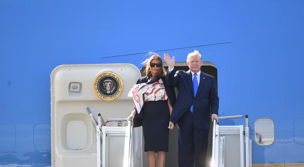 US President Donald Trump and his wife Melania arrive at Stansted Airport in Essex, aboard Air Force One, for the start of his three day state visit to the UK.