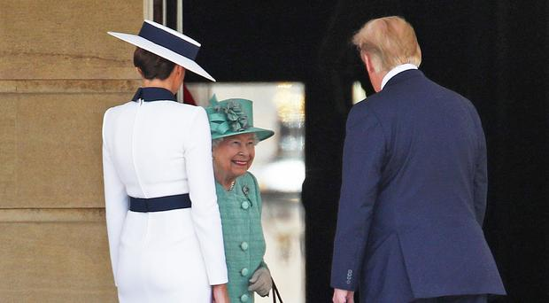 US President Donald Trump and his wife Melania are welcomed by the Queen (Yui Mok/PA)