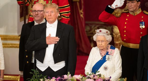 US President Donald Trump and the Queen during the state banquet (Dominic Lipinski/PA)