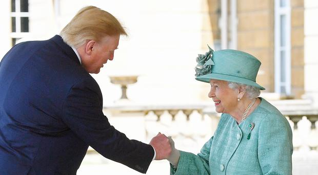 Donald Trump appears to greet the Queen with a fist bump (Victoria Jones/PA)
