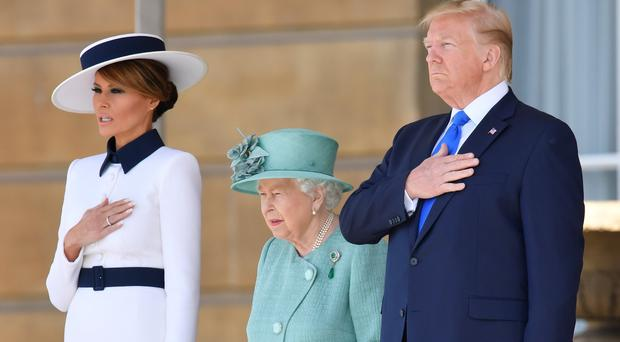 (Left to right) First Lady Melania Trump, Queen Elizabeth II and US President Donald Trump (Toby Melville/PA)