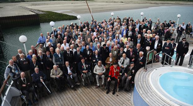 A group photo of the D-Day veterans travelling on board the MV Boudicca as it arrives into Dunkirk, France (Kirsty O'Connor/PA)