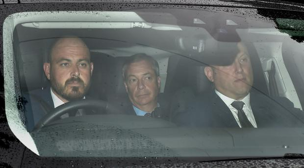 Brexit Party leader Nigel Farage (centre) arrives at Winfield House, the residence of the US Ambassador to the UK (David Mirzoeff/PA)