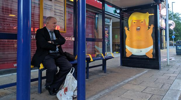 A campaign group has plastered images of the Trump blimp onto bus shelters in Portsmouth ahead of the president's visit (Special Patrol Group/PA)