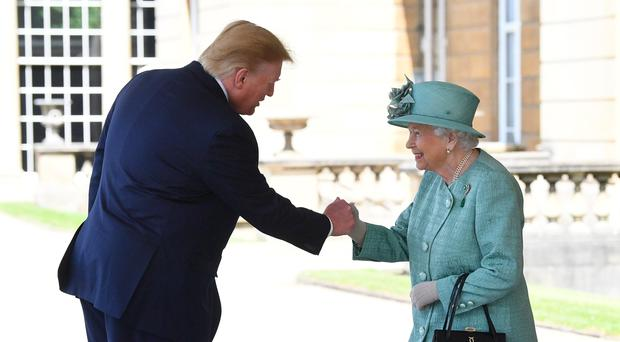 The Queen greets US President Donald Trump as he arrives at Buckingham Palace (Victoria Jones/PA)
