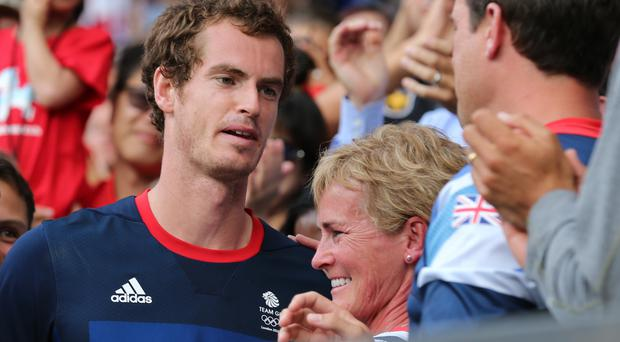 Judy Murray (centre) says her grand slam-winning sons Sir Andy (left) and Jamie would still have to leave Scotland if they were teenagers now due to lack of tennis opportunities in Scotland (Andrew Milligan/PA)