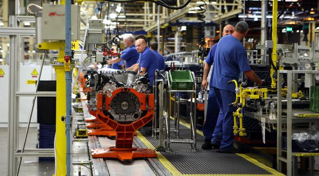 Engineers working on a Jaguar V8 engine at the Ford engine plant near Bridgend, South Wales (David Jones/PA)
