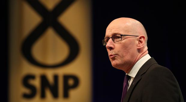 Deputy First Minister John Swinney stood in for Nicola Sturgeon at First Minister's Questions (Andrew Milligan/PA)
